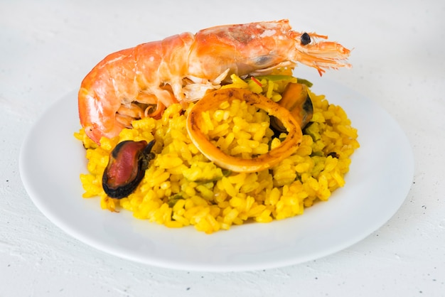 Paella typical spanish food in granite background