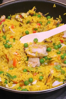 Paella with fish and meat