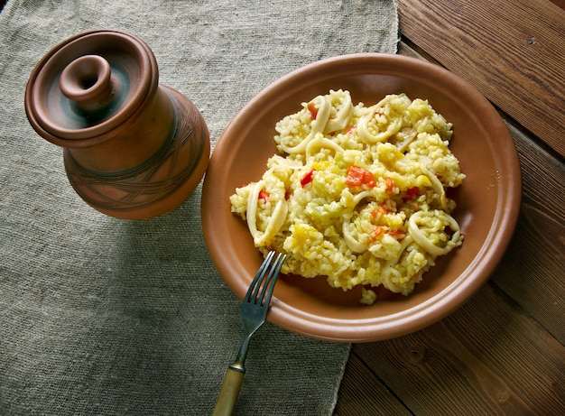 Paella with squid, pumpkin and sweet peppers