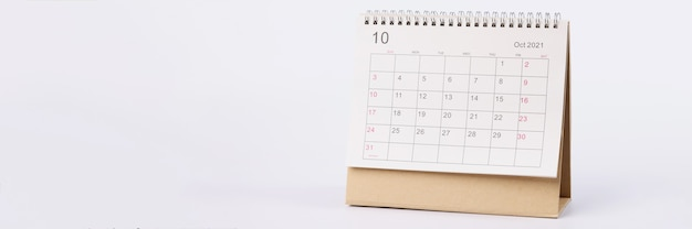 Page with dates of october is open on desk calendar closeup