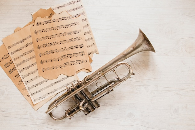 Pages of sheet music near trumpet
