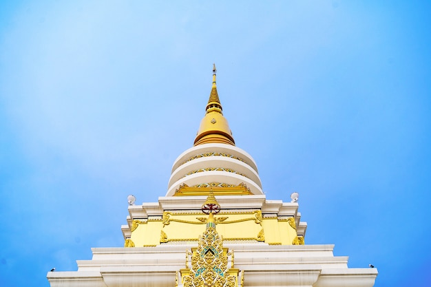 Pagoda in buddha temple on the beautiful cloudy sky , asia , thailand