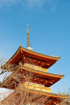 The pagoda of kiyomizu-dera, kyoto, japan with sunny day and blue sky