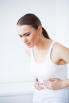 Pain stomach, woman having painful stomachache