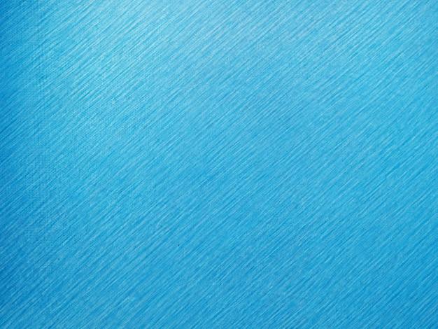 抽象的なグランジをペイントします。キャンバスの抽象的な背景とテクスチャの青い線の鉛筆で装飾的な青い暗い壁グラデーションカラー抽象的な背景。 Premium写真
