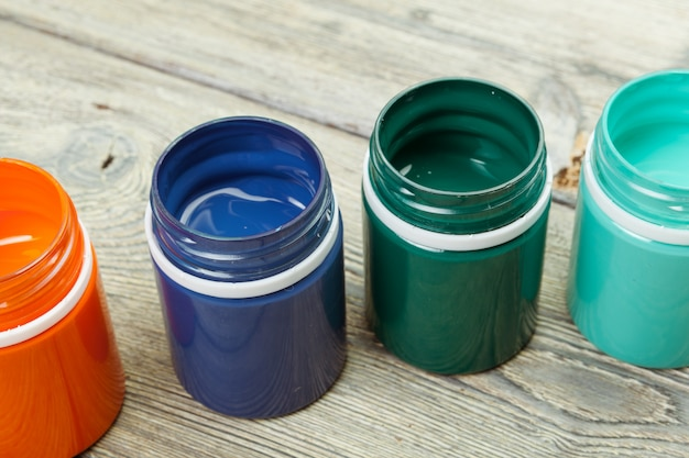Paint bottels on rustic wooden
