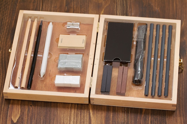 Paint box on wooden table