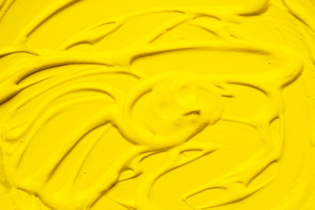 Paint of bright yellow color in smudge