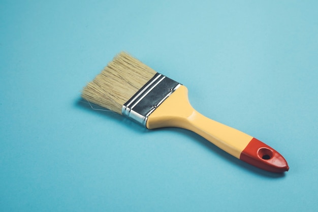 Paint brush on the blue table