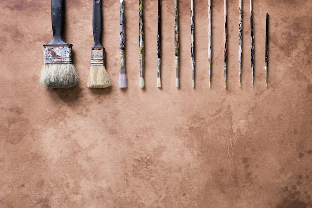 Paint brush on old parchment paper vintage aged or texture background.