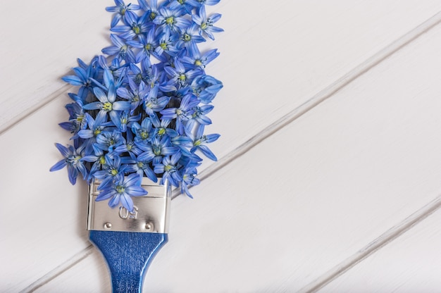 Paint brush with flowers on white background