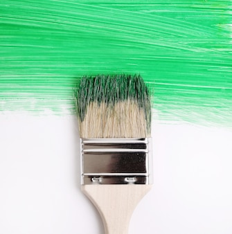 Paint brush with green paint