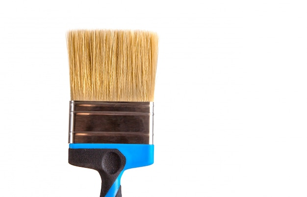 Paint brush with natural bristles on a white isolated background.