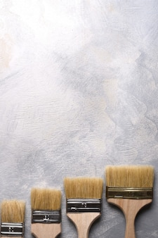 Paint brushes on a gray concrete. top view. flat lay