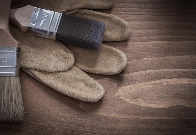 革保護手袋の建設コンセプトにブラシをペイントします。