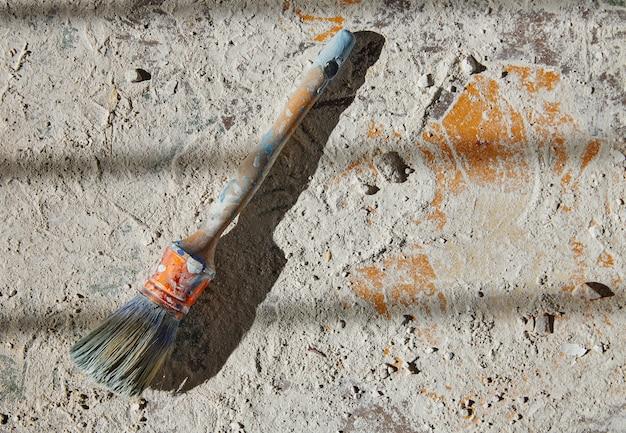 Paint brushes used on debris improvement