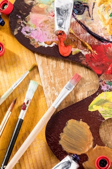 Paint brushes with palette and paint tube