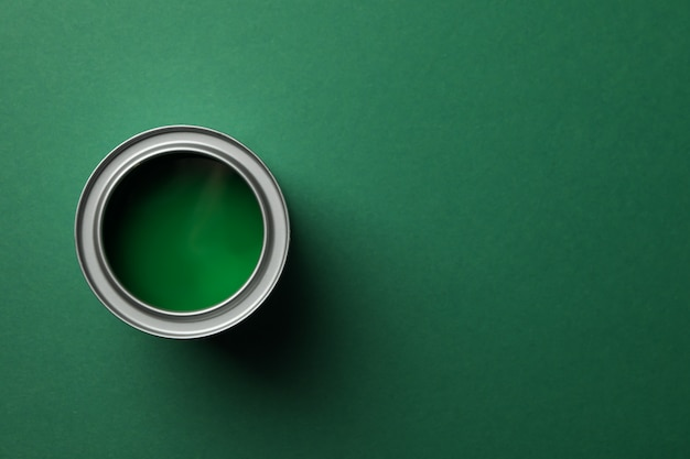Paint can on green surface