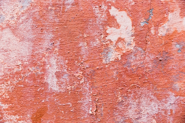 Paint on coarse concrete wall surface
