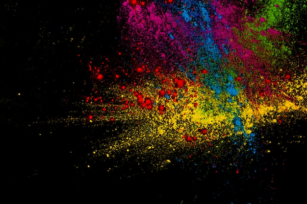 Paint colorful powder explosion over dark surface