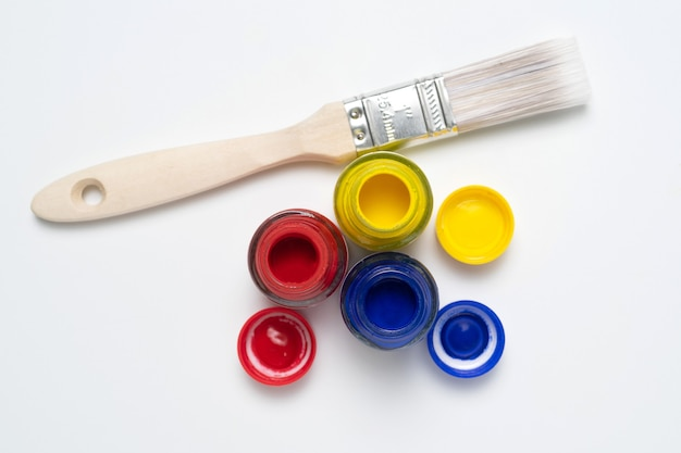 Paint colors in the tubes and a brush.