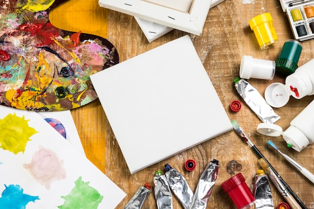 Paint essentials with canvas and palette
