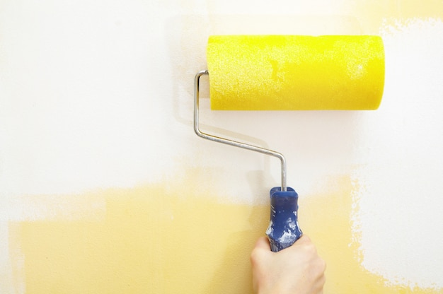 Paint roller on a wall.