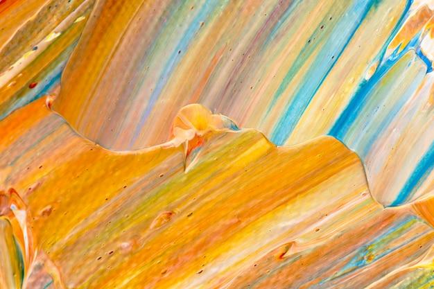 Dipingi il fondo strutturato della macchia nell'arte creativa di stile astratto arancione