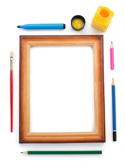 Paint supplies and frame on white