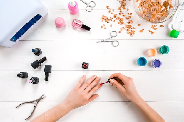 Paint your own nails. manicure set and nail polish on wooden background. top view. copy space. still life. nail care.