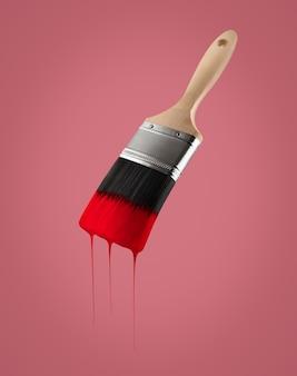 페인트 브러시 붉은 배경에 bristles- 격리에서 떨어지는 붉은 색으로로드.