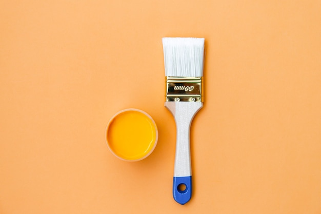 Paintbrush on orange background