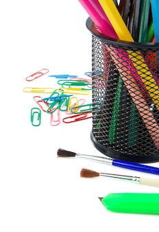 Paintbrush, paper clips and pencil in holder isolated