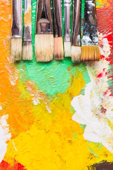 Paintbrushes on strokes of paint
