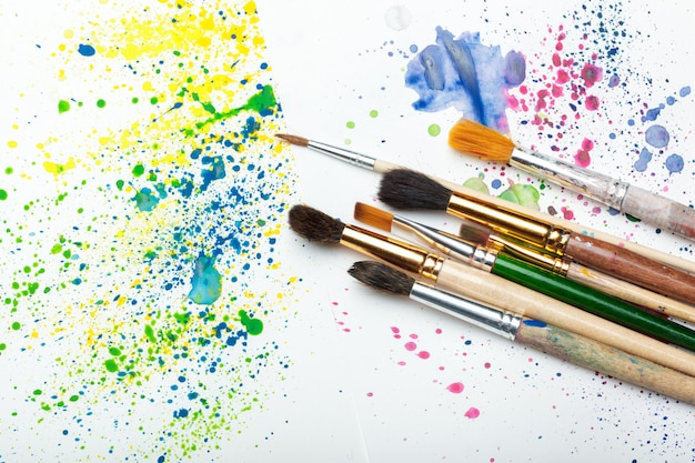 Paintbrushes and watercolor abstract art