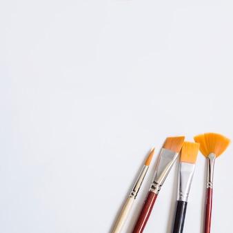 Paintbrushes on white surface