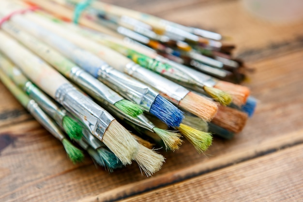 Paintbrushes on wooden table