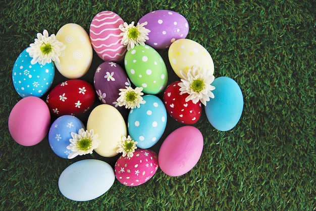 Painted colorful easter eggs background - easter holiday celebration background concept