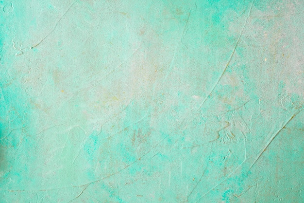 Painted concrete weathered turquoise wall