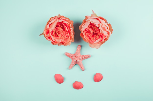 Painted coral peonies flowers; starfish and clams on mint background