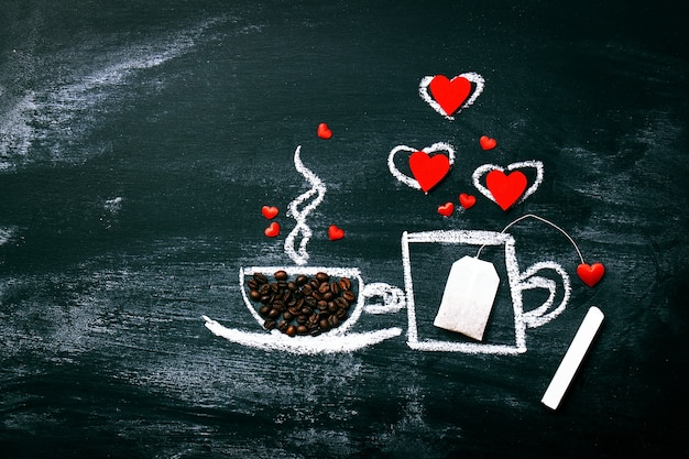Painted cup of coffee and tea on an old chalkboard. love or vale