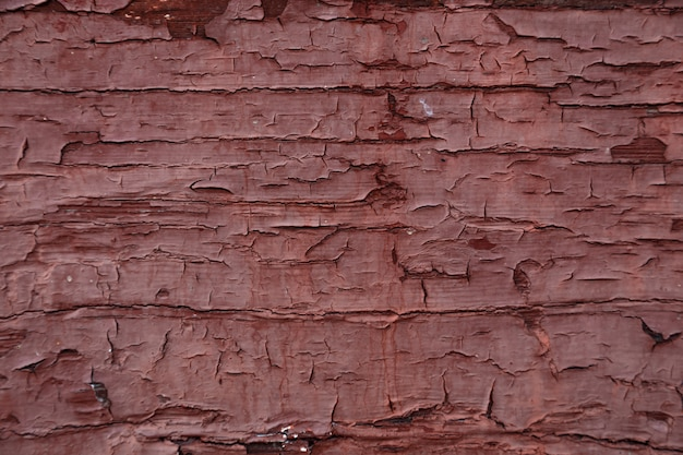 Painted dark red old wooden wall texture, rustic background