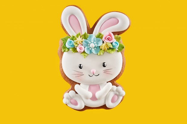 Painted easter bunny cookie over yellow background