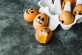 Painted eggs with faces in Halloween style