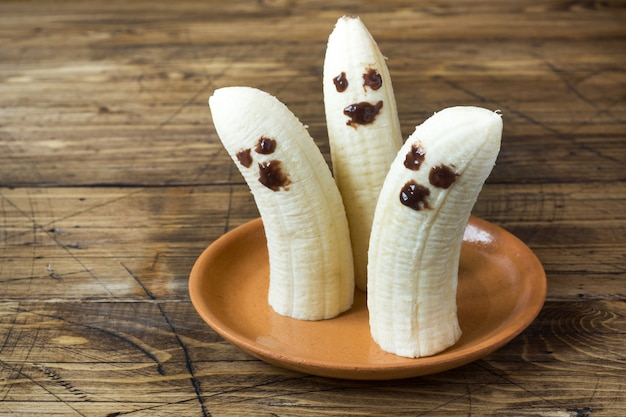 Painted funny faces on bananas for halloween