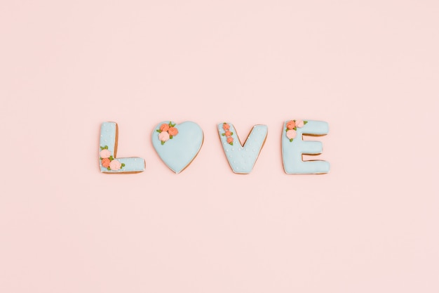 Painted gingerbread in shape of word love.  for valentines day, wedding. love romance concept. top view with space for your text.