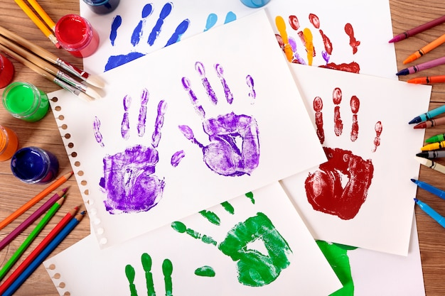 Painted handprints with art equipment