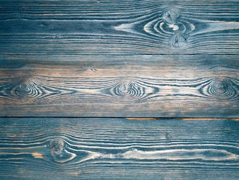 Painted in blue, dark blue, wooden background from pine boards,