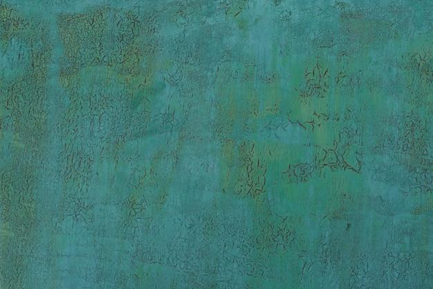 Окрашены в зеленый старый треснувший металл ржавый фон.