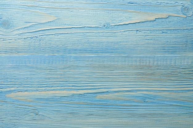 塗られた水色の織り目加工の木製の背景
